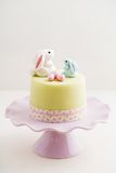 Easter bunny cake. Easter cake with bunnies and eggs made of fondant Stock Photography