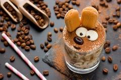 Easter bunny cake tiramisu dessert for children. Funny traditional Italian dessert serving, creative idea holiday sweet food for kids selective focuse stock photos