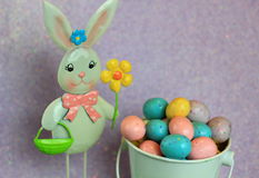 Easter Bunny and Candy Speckled Easter Eggs. Variety of Candy speckled Easter eggs in a white bucket Stock Images