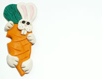 Easter bunny with carrot. Horizontal Easter bunny with carrot royalty free stock photos