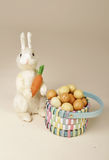 Easter Bunny with Carrot and Eggs Stock Photo