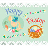 Easter bunny with carrots and colored eggs and willow branch. Stock Photography