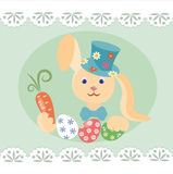 Easter bunny with carrots and  eggs Royalty Free Stock Photography