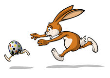 Easter bunny is chasing a easter egg Stock Photo