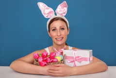 Easter bunny childhood. Little cute easter female waiting for gifts stock photo