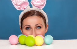 Easter bunny childhood. Little cute easter female waiting for gifts royalty free stock photography