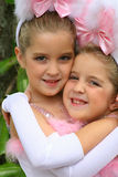 Easter bunny children. Little girls giving a big hug Stock Photos
