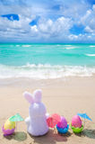 Easter bunny and color eggs on the beach Royalty Free Stock Photos