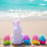 Easter bunny and color eggs on the beach - Instgram format Stock Image