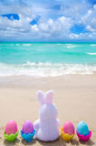 Easter bunny and color eggs on the beach Royalty Free Stock Photo