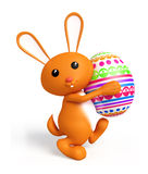 Easter bunny with color full egg. 3d Easter bunny with egg Royalty Free Stock Photo