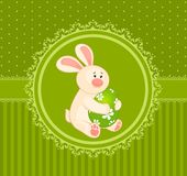 Easter Bunny with colored egg. Royalty Free Stock Image