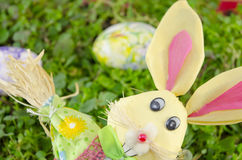 Easter bunny and a colored egg on the grass Royalty Free Stock Photography