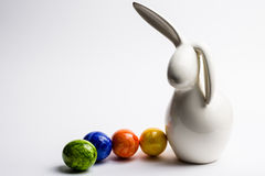 Easter bunny. With colored eggs Royalty Free Stock Photography