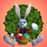 Easter bunny with colored eggs royalty free stock photography