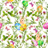 Easter bunny with colored eggs in grass, flowers, butterflies. Seamless floral easter pattern with egg hunt. Watercolor Royalty Free Stock Photo