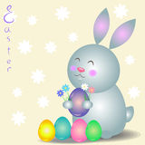 Easter bunny and colored eggs. One easter bunny and gold, pink, purple, blue, green eggs Royalty Free Stock Photography