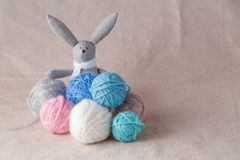 Easter bunny in colored wool clew Royalty Free Stock Photos