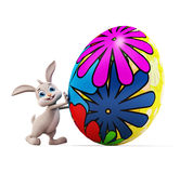 Easter Bunny with colorful eggs Stock Photos