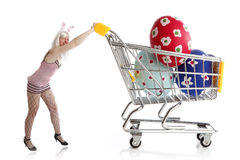 Easter bunny with colorful eggs in her shopping cart. Female Easter bunny with colorful eggs in her shopping cart Royalty Free Stock Photos