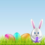 Easter bunny and colorful eggs on spring medow Royalty Free Stock Photos