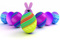 Easter bunny and colorful eggs on white background Royalty Free Stock Photos
