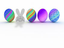 Easter bunny and colorful eggs  on white Stock Images