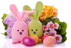 Easter bunny with colorful flowers and easter eggs Royalty Free Stock Photos