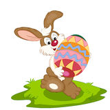 Easter bunny. With colorful painted egg Stock Photos
