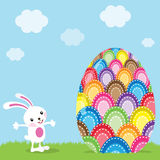 Easter Bunny and Colorful Painted Egg Stock Image