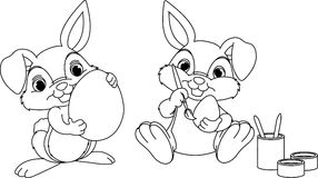Easter Bunny coloring page. Easter Bunny painting eggs coloring page Royalty Free Stock Photography