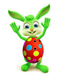 Easter Bunny with colourful eggs saying hi pose Royalty Free Stock Image