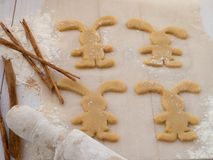 Easter Bunny cookies, cinnamon sticks and roller-pin Royalty Free Stock Photography