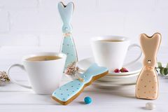 Easter bunny cookies and cup of tea. Celebration breakfast table setting. stock photography