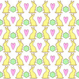 Easter bunny cookies pattern with spring flowers and hearts. Royalty Free Stock Photo