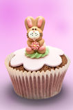 Easter Bunny Cupcake. Easter bunny rabbit cupcake on graduated pink background Royalty Free Stock Photo