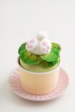 Easter bunny cupcake. Cupcake with a fondant Easter bunny topper. Bunny is digging in fondant salad with his butt and feet sticking out Royalty Free Stock Images