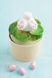 Easter bunny cupcake. Cupcake with a fondant Easter bunny topper. Bunny is digging in fondant salad with his and feet sticking out royalty free stock image