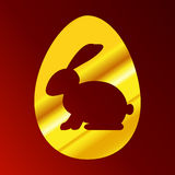 Easter Bunny cut out in the Golden egg. On red background Vector Illustration