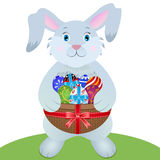 Easter bunny. Cute   and eggs on  green grass with scroll paper Royalty Free Stock Image
