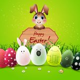 Easter bunny with cute Easter eggs and wooden sign on green background Stock Photos