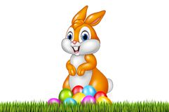 Easter bunny with decorated Easter eggs in a field Royalty Free Stock Photo