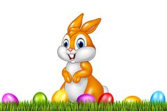 Easter bunny with decorated Easter eggs in a field Stock Photography