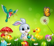 Easter bunny with decorated Easter eggs in a field. Illustration of Easter bunny with decorated Easter eggs in a field Stock Photo