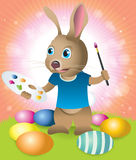 Easter Bunny Decorating Easter Eggs. Cute easter bunny painting and decorating easter eggs in the grass vector illustration