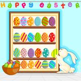 Easter Bunny decorating painted egg Royalty Free Stock Images