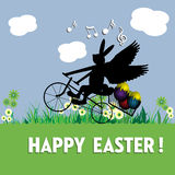 Easter bunny delivering eggs stock images