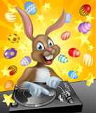 Easter Bunny DJ. Cartoon Easter bunny DJ playing music at the the decks or turn tables with chocolate Easter eggs in the background royalty free illustration