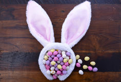 Easter bunny ears with candy eggs Stock Images