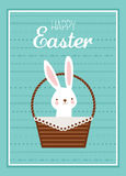 Easter bunny with Easter basket full of Easter eggs Stock Photo